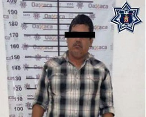 Policía estatal detiene con arma de fuego a Víctor Mendoza, presidente del Consejo de Vigilancia del Comisariado de los Bienes Comunales de Huatulco.